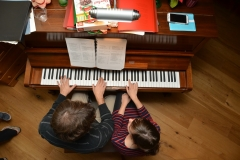 Playing four-hand piano repertoire with husband, Benjamin Krause